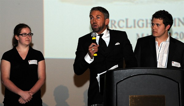 New York Film Academy rep Benjamin Morgan awards scholarships as directors Lauren Bailey and Jon Haile look on.