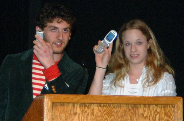 Max Freedman and Cathy Pitoun ask the audience to silence their cell phones.