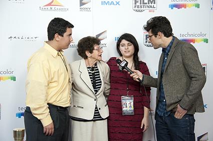The Seek the Truth creative team including Purag Moumdjian, Holocaust survivor Helen Freeman, and Sofia Barrett are interviewed by Jacob Soboroff.