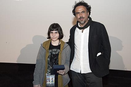 Stephanie Delazari (The Horror, In the Home) accepts her award from Alejandro Iñárritu.
