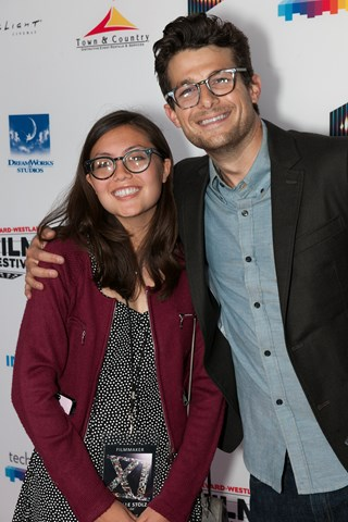Danielle Stolz, director of Anaerobe and Wings of Peace, smiles for the camera with Jacob Soboroff.