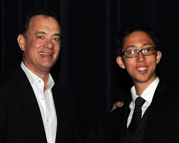 """Tom Hanks with """"How to Save a Life"""" director Joe Sill."""