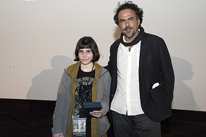 Stephanie Delazari (The Horror, In the Home) accepts her award from Alejandro Iñárritu.